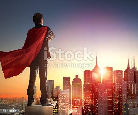 istock superhero businessman looking at city 514169944