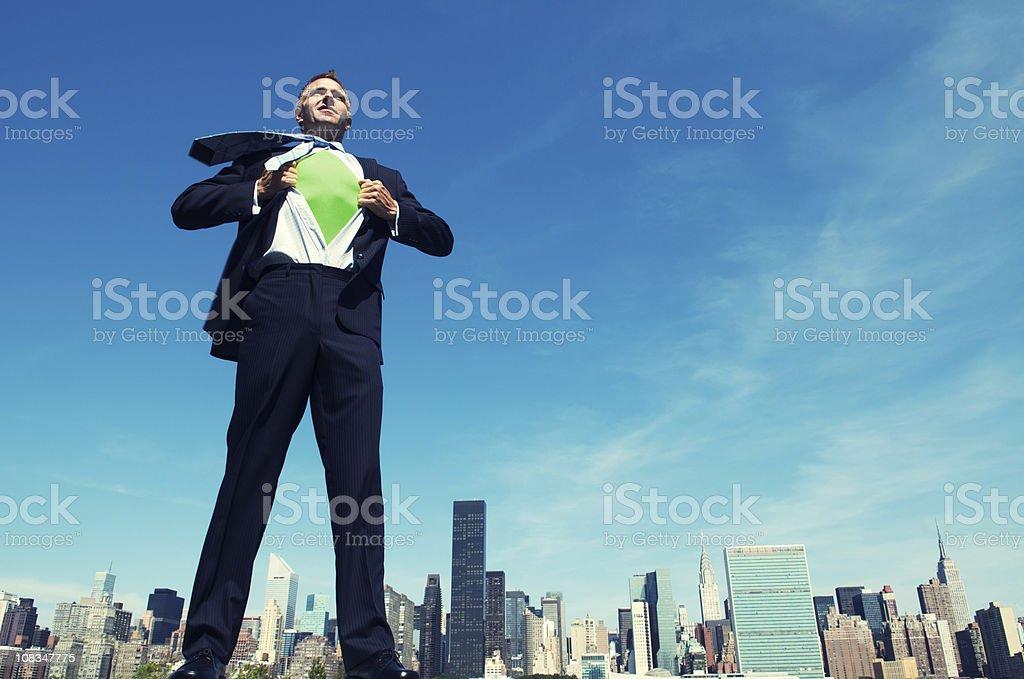 Superhero Businessman Smiling Standing above City Skyline royalty-free stock photo