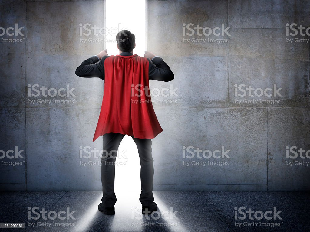 Superhero Businessman Trying To Escape stock photo
