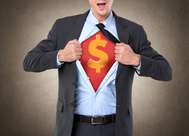 Superhero businessman with dollar sign on his chest Businessman tearing off his shirt with dollar sign on chest fully unbuttoned stock pictures, royalty-free photos & images
