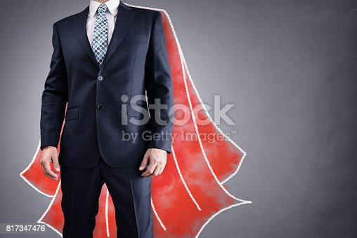 istock Superhero businessman with red cape concept for leadership 817347476