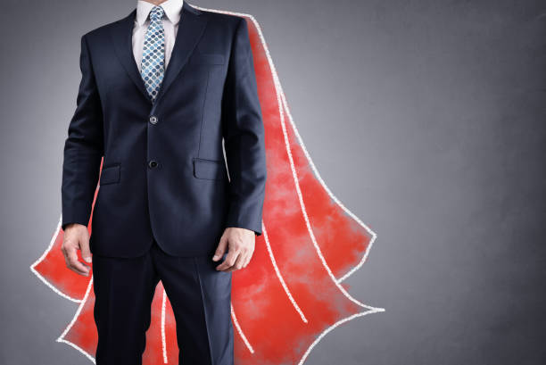 Superhero businessman with red cape concept for leadership stock photo