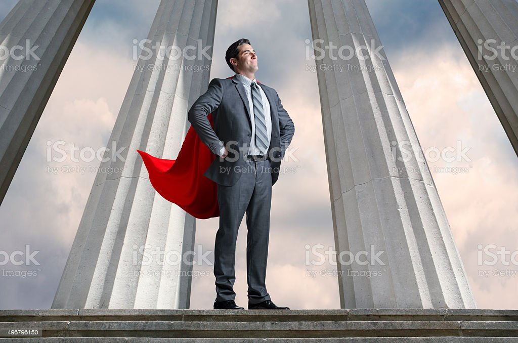 Superhero Businessman With Tall Pillars In The Background stock photo