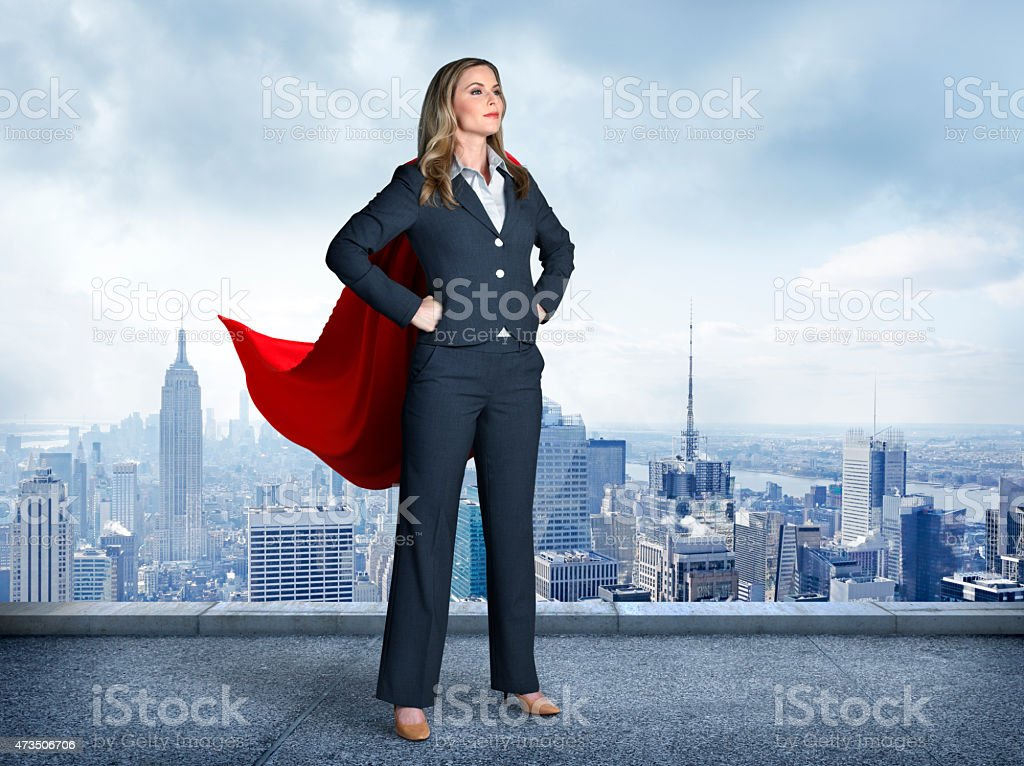 Superhero Businesswoman With Cityscape In The Background royalty-free stock photo