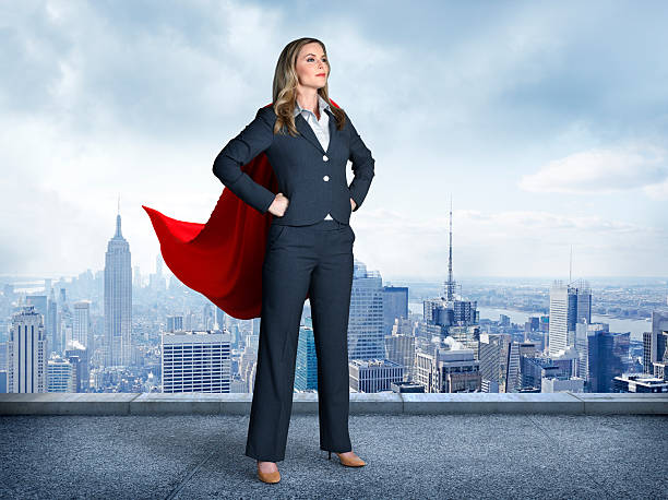 Superhero Businesswoman With Cityscape In The Background stock photo