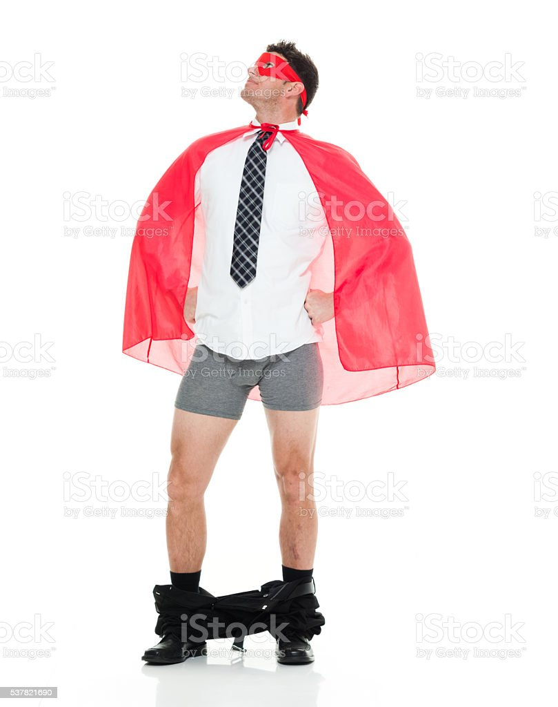 Superhero caught with his pants down stock photo