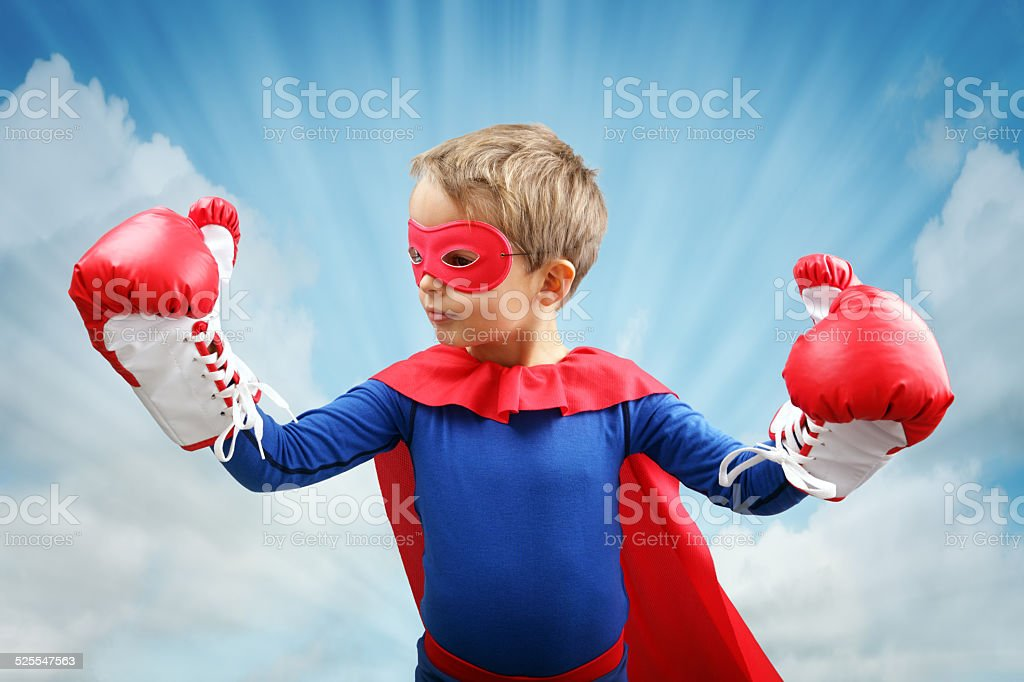 Superhero child with boxing gloves stock photo