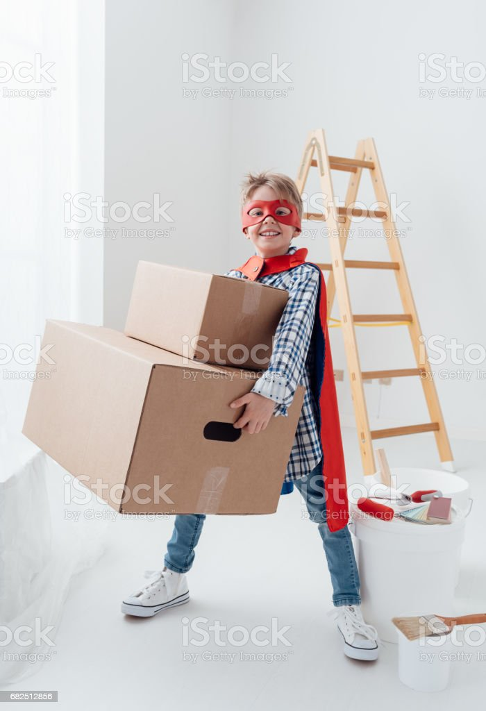 Superhero doing home renovation foto de stock libre de derechos