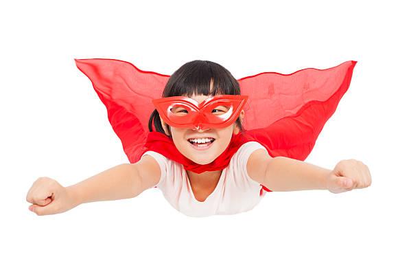 superheld kind fliegen, isoliert auf weißem hintergrund - camouflagekleidung mädchen stock-fotos und bilder