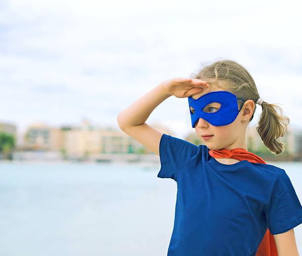 superhero kid looking into distance. - superwoman barn bildbanksfoton och bilder