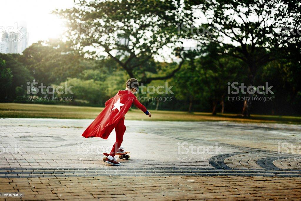 Superhero Kid Playful Happiness Leisure Activity Concept stock photo