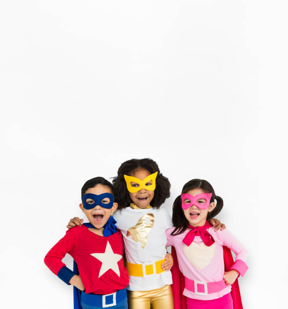 Superhero Kid Smiling Friendship Togetherness stock photo