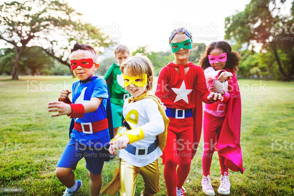 Superhero Kids Aspiration Imagination Playful Fun Concept stock photo
