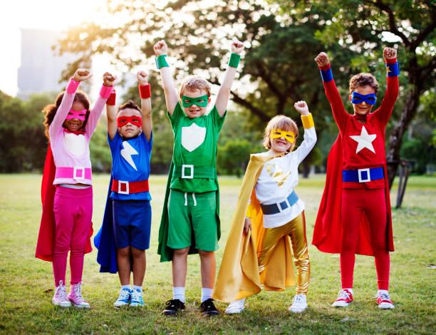 Superhero kids with superpowers stock photo