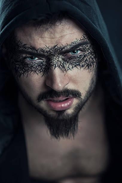 superheld männlich unter der kapuze - teufel schminken stock-fotos und bilder