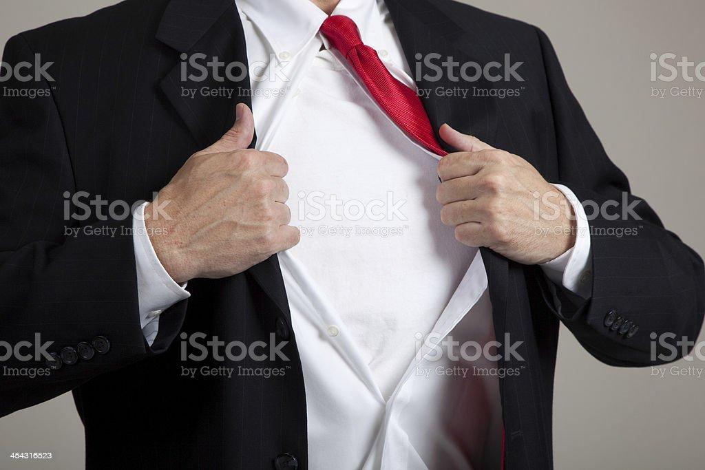 Superhero opening suit stock photo