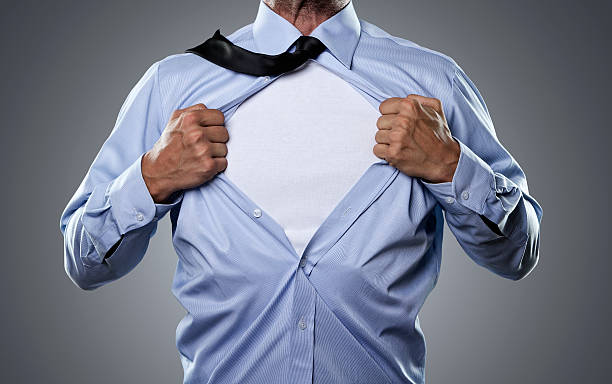 Superhero Young businessman tearing his shirt off isolated on gray background with copy space undressing stock pictures, royalty-free photos & images