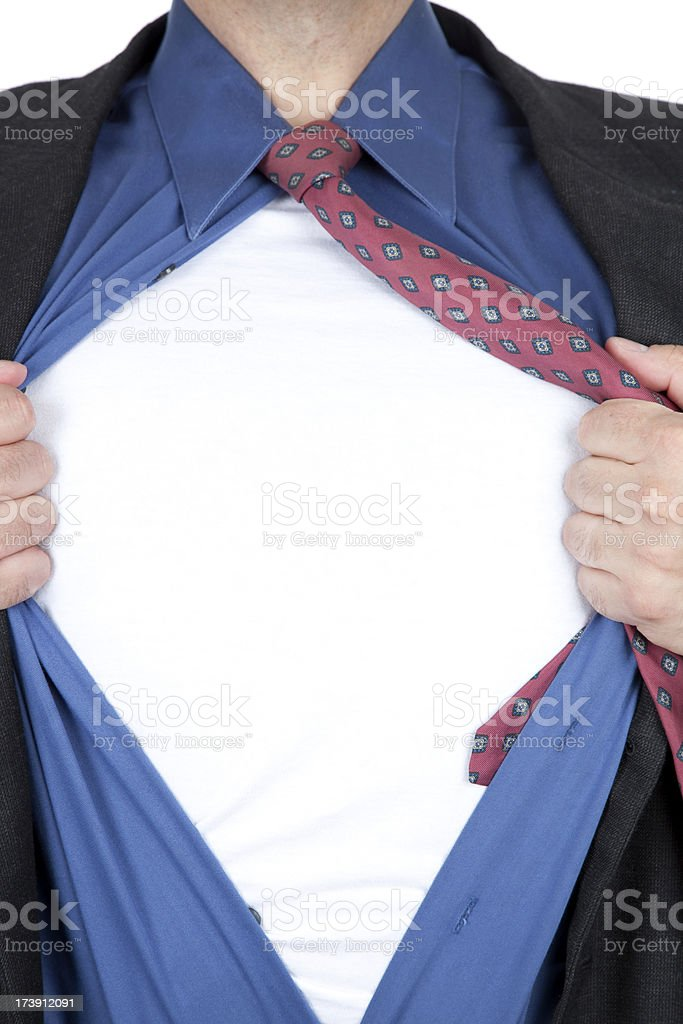 Superhero Pose - Business Shirt open and revealing t-shirt royalty-free stock photo