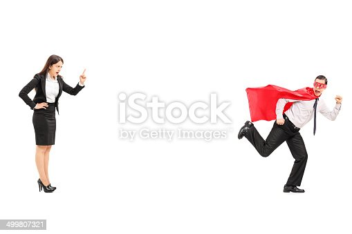 516318379istockphoto Superhero running away from angry businesswoman 499807321