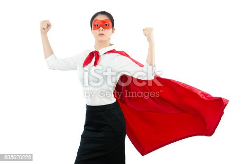 istock superhero showing her strong muscle 835620228