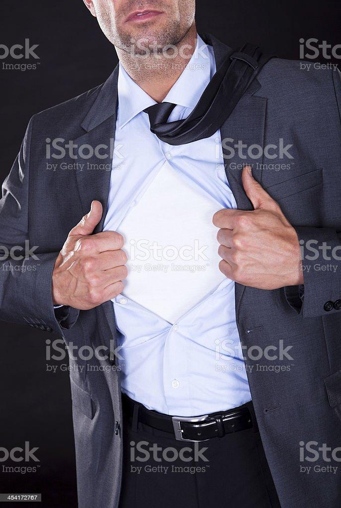 Superhero Tearing Off His Shirt royalty-free stock photo