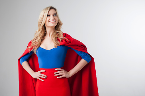 istock Superhero Woman. Young and beautiful blonde in image of superheroine 637481892