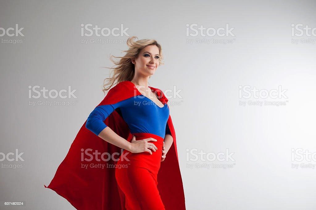 Superhero Woman. Young and beautiful blonde in image of superheroine - foto de stock