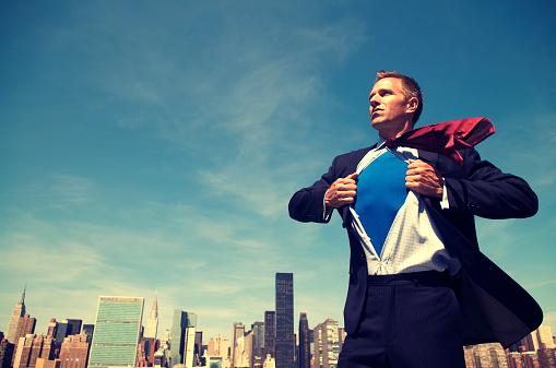 Superhero Young Man Businessman Standing Outdoors Over City Skyline