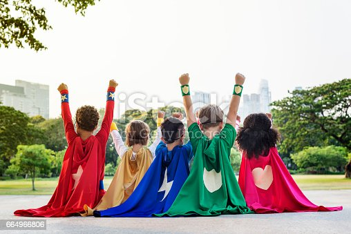 istock Superheroes Cheerful Kids Expressing Positivity Concept 664966806