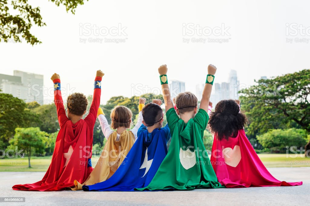 Superheroes Cheerful Kids Expressing Positivity Concept - foto stock