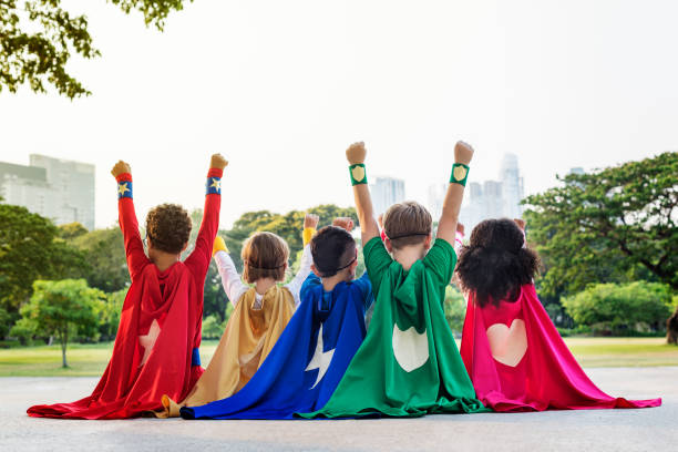superheroes cheerful kids expressing positivity concept - gefühle vorschul stock-fotos und bilder