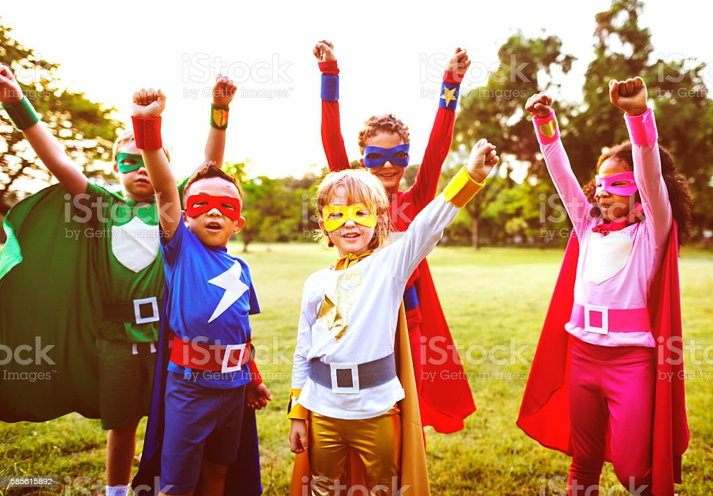 Superheroes Kids Friends Playing Togetherness Concept stock photo
