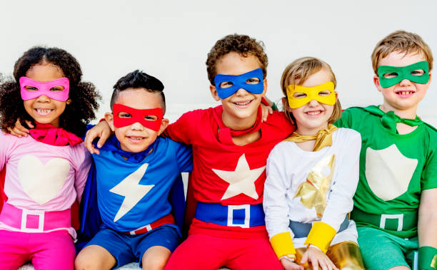 superheroes kids friends playing togetherness concept - super hero stock pictures, royalty-free photos & images
