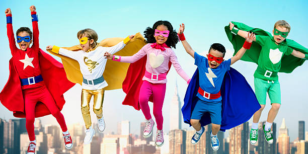 superheroes kids friends playing togetherness fun concept - super hero stock pictures, royalty-free photos & images