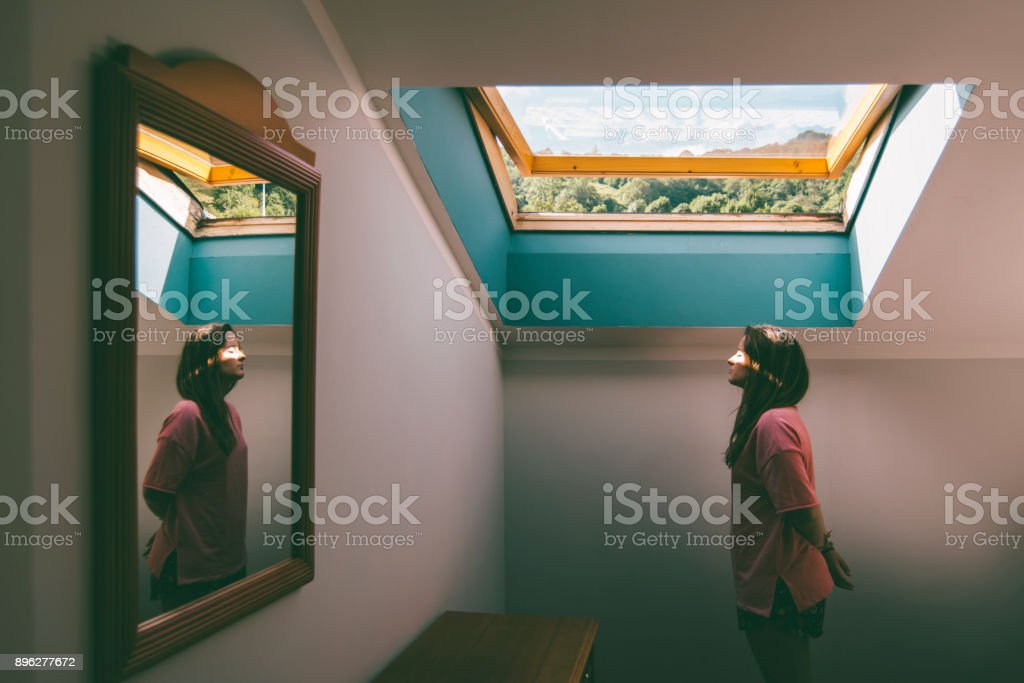 Superheroine - Woman with eyes closed at domestic room stock photo