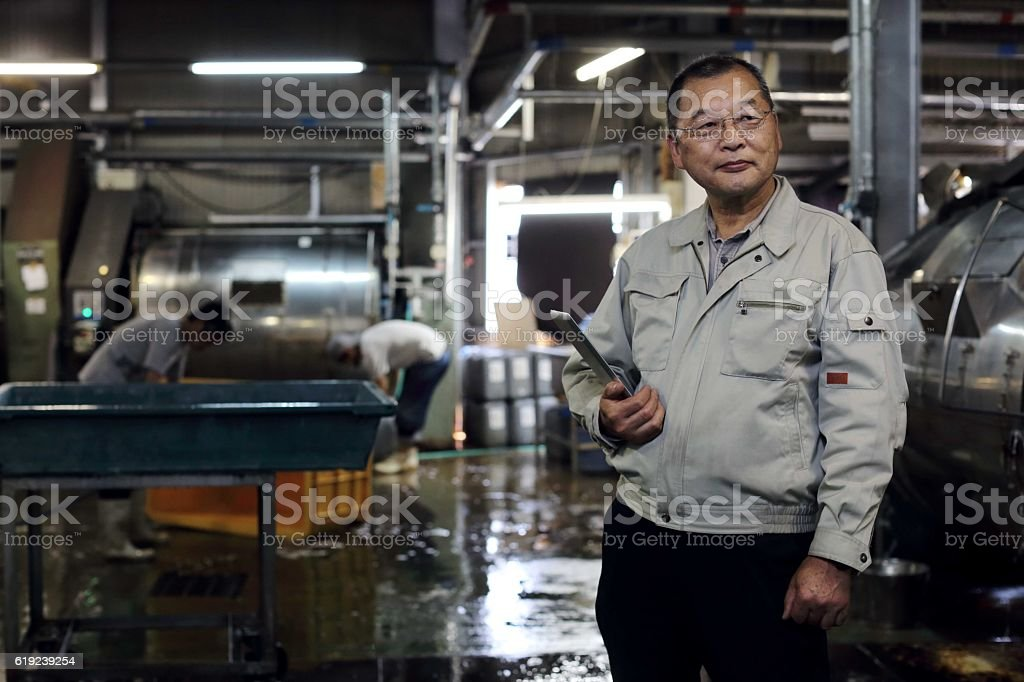 Superintendent of a denim factory stock photo