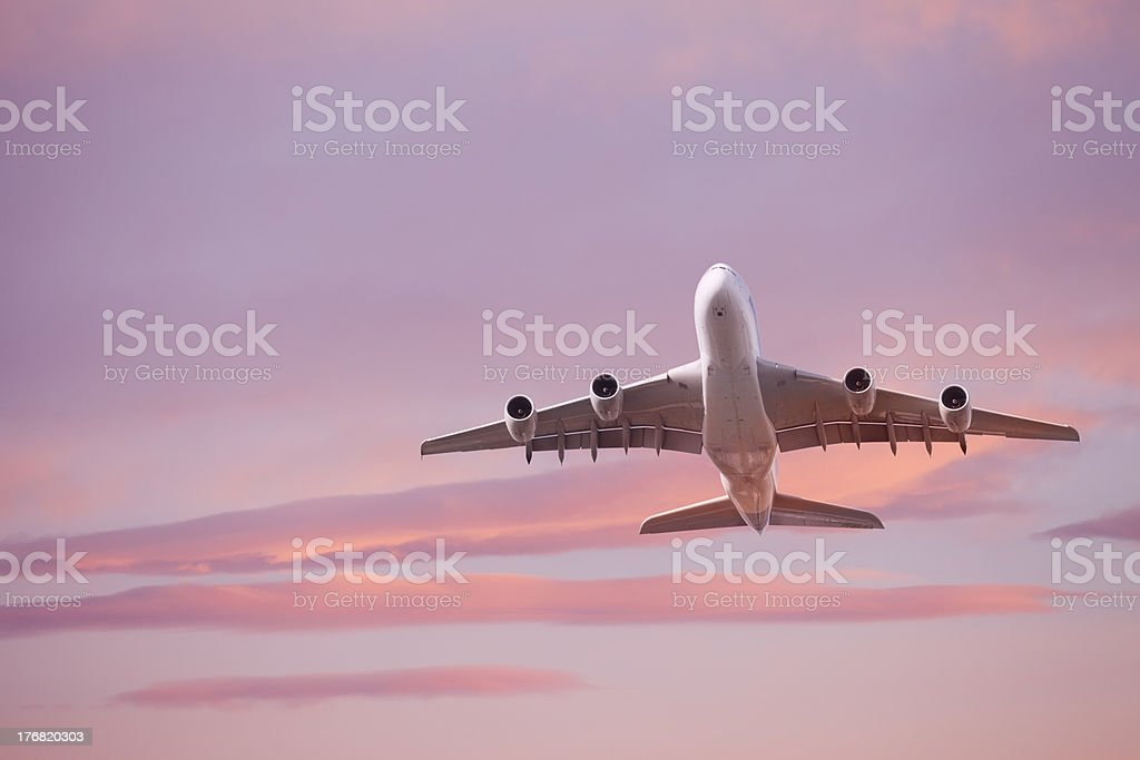 Superjumbo Airliner Taking Off at Sunset stock photo