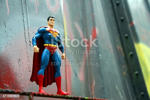 Whistler, Canada - June 15, 2013: An action figure model of Superman, sculpted by Paul Harding and released by DC comics, against a bent metal.