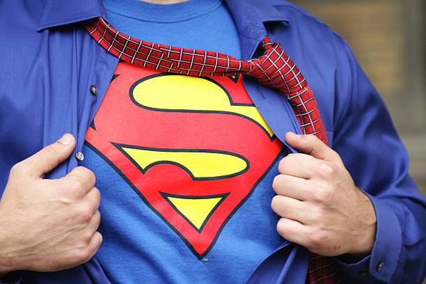 Superman Costume on Strong Young Man stock photo