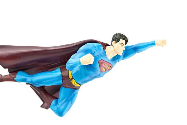 superman fliegen - cartoon kostüme stock-fotos und bilder