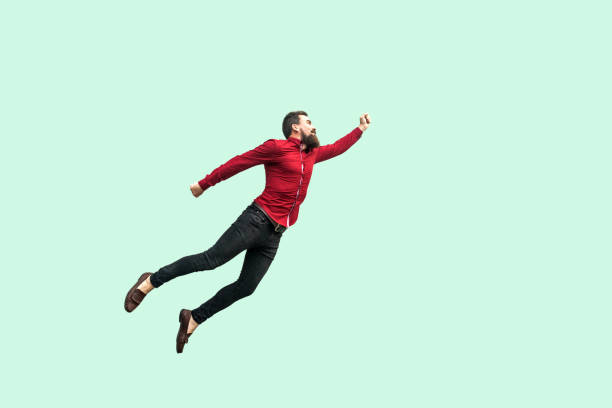 superman style. enthusiasm concept. strong bearded businessman felt himself a superhero and flying up. - mid air stock pictures, royalty-free photos & images