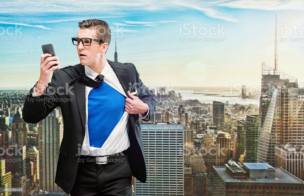 Superman taking a selfie outdoors in the city stock photo