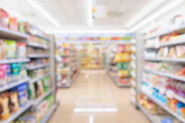 Supermarket aisle interior shelves blur background Supermarket aisle interior shelves blur background snack aisle stock pictures, royalty-free photos & images