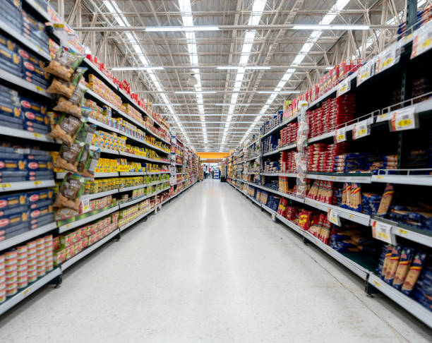 Supermarket aisle with shelfs full of a variety of products Supermarket aisle with shelfs full of a variety of products - Business concepts supermarket stock pictures, royalty-free photos & images