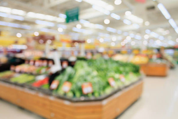 supermarket blur background Fruits and vegetables on shelves in supermarket blur background produce aisle stock pictures, royalty-free photos & images