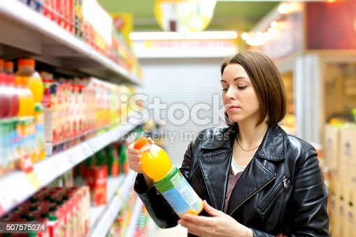 supermarket buying a bottle of juice