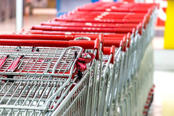 Supermarket cart - trolleys in a row stock photo