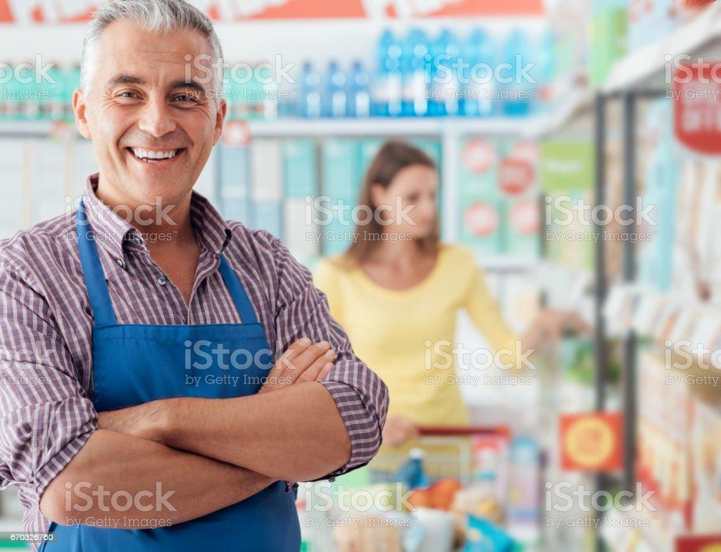 Supermarket clerk portrait stock photo