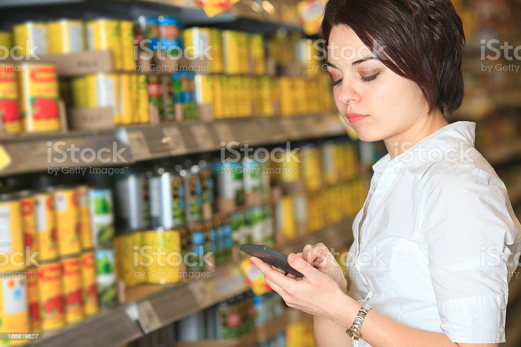 Supermarket Client - Calculator Woman royalty-free stock photo