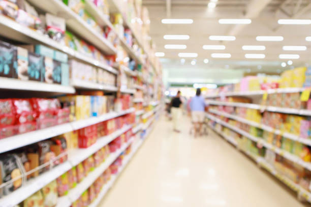 supermarket discount store aisle and product shelves interior abstract defocused  blur background supermarket discount store aisle and product shelves interior abstract defocused  blur background snack aisle stock pictures, royalty-free photos & images